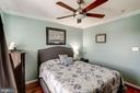 Upper lvl Bedroom 1, crown molding throughout home - 25046 MINERAL SPRINGS CIR, ALDIE