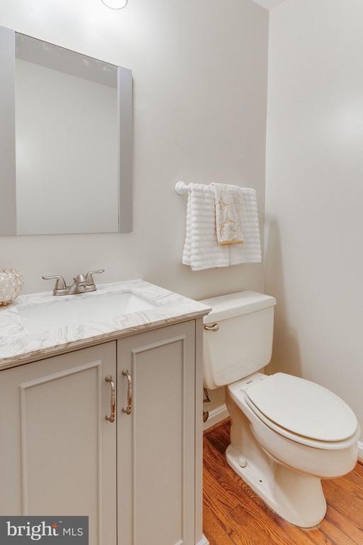 Updated powder room with new vanity & mirror - 1726 CY CT, VIENNA