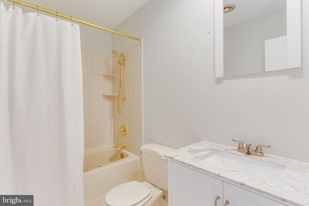 Updated hall bath w/new vanity & mirror - 1726 CY CT, VIENNA