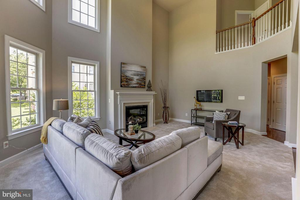 Family room showing two story overlook from upper - 4793 CHARTER CT, WOODBRIDGE