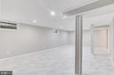 New Tile Floor in the Basement Family Room - 5202 CEDAR RD, ALEXANDRIA