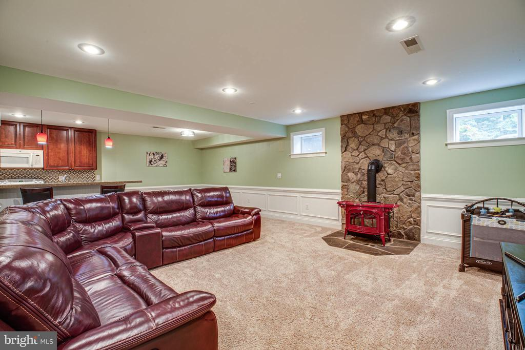 Basement family room with wood burning stove - 12401 TOWER RD, UNIONVILLE