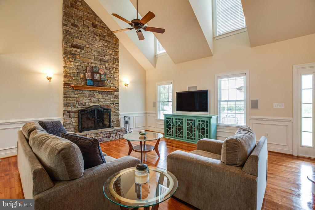 Family room with 2 story stone fireplace - 12401 TOWER RD, UNIONVILLE
