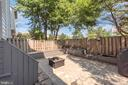 Newer patio with built in composite bench. - 46796 FAIRGROVE SQ, STERLING