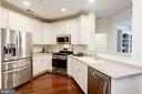 Kitchen - New Hardwood Floors! - 828 SLATERS LN #105, ALEXANDRIA