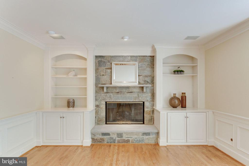 Stone fireplace and mantel w/ custom built-ins - 3111 WINDSONG DR, OAKTON