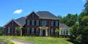 Grand Brick Front Nestled Next to Mature Trees - 16028 WATERFORD MEADOW PL, HAMILTON