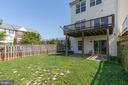 Backyard with end unit fence run - 126 FIELDSTONE CT, FREDERICK