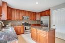 Gourmet kitchen with granite & tile backsplash - 22 SAINT CHARLES CT, STAFFORD
