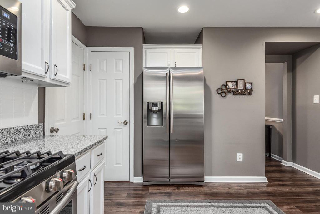 Kitchen has a pantry to the left of the fridge. - 31 AURELIE DR, FREDERICKSBURG