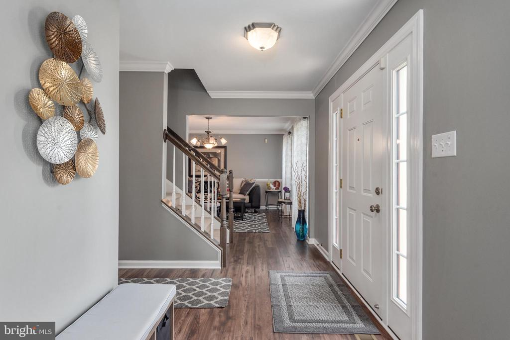 Front foyer & hall have crown molding. - 31 AURELIE DR, FREDERICKSBURG