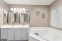 Master bathroom features double vanity. - 31 AURELIE DR, FREDERICKSBURG