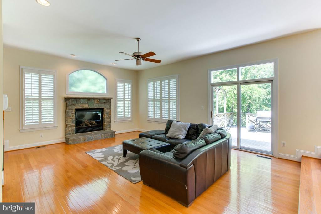 Light-filled Family Room with Gas Fireplace - 12000 CREEKBEND DR, RESTON