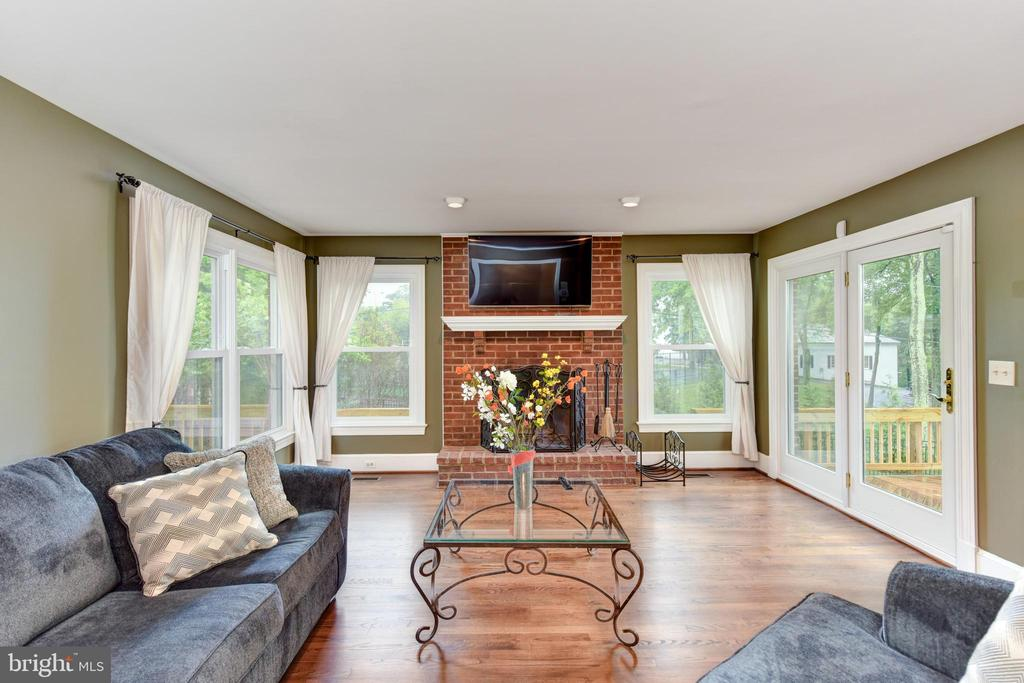 Family Room with brick fireplace and doors to deck - 4201 KIMBRELEE CT, ALEXANDRIA