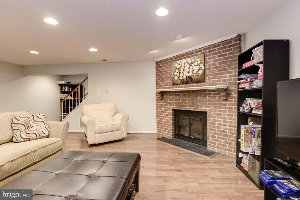 Family Room with Brick Fireplace - 5720 CROWNLEIGH CT, BURKE
