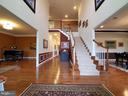 Basement stairs are down the hall to the right. - 41882 SCOTCHBRIDGE PL, ASHBURN