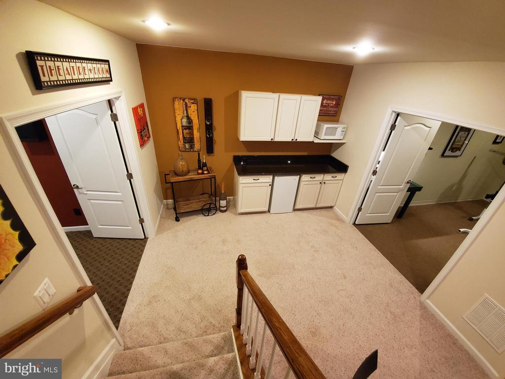 Theater on the left and gym on the right. - 41882 SCOTCHBRIDGE PL, ASHBURN