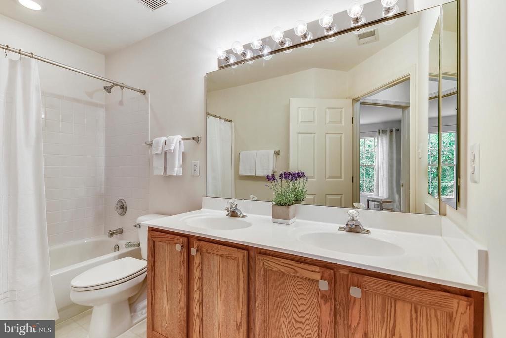 Spacious  hall bath features a double vanity - 20529 ASHLEY TER, STERLING