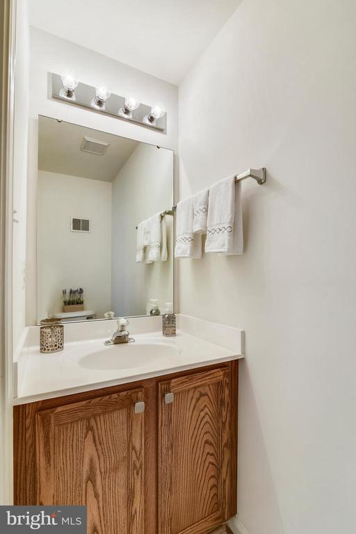 Powder room is a  convenient feature on this level - 20529 ASHLEY TER, STERLING