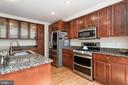 UPDATED KITCHEN WITH SS APPLIANCES - 46801 WOODSTONE TER, STERLING