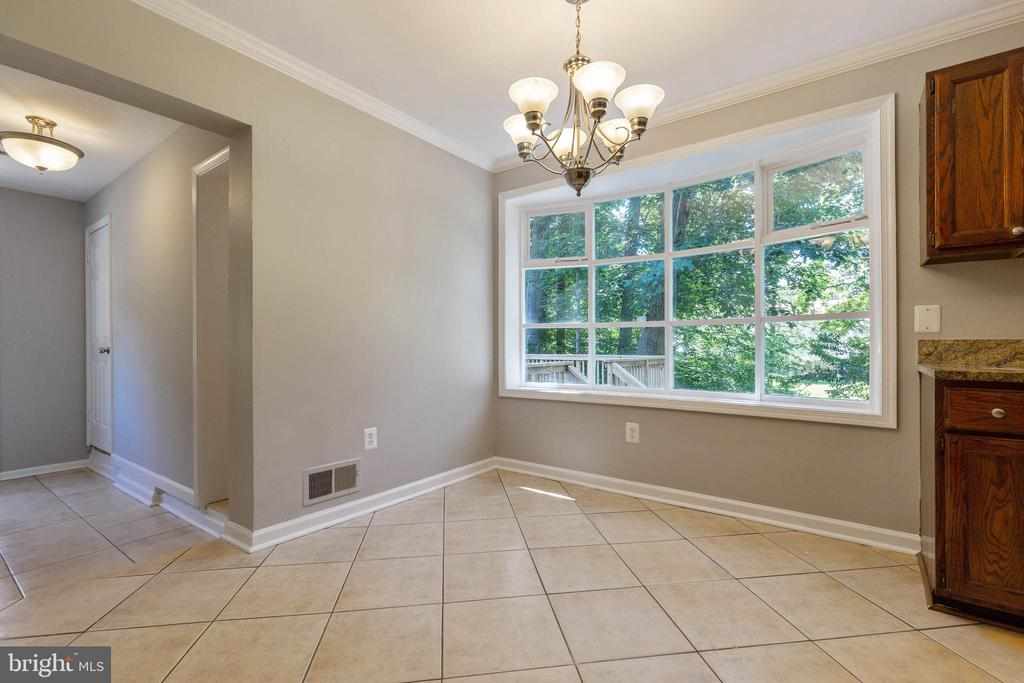 Kitchen table area has a beautiful backyard view - 5119 LAVERY CT, FAIRFAX