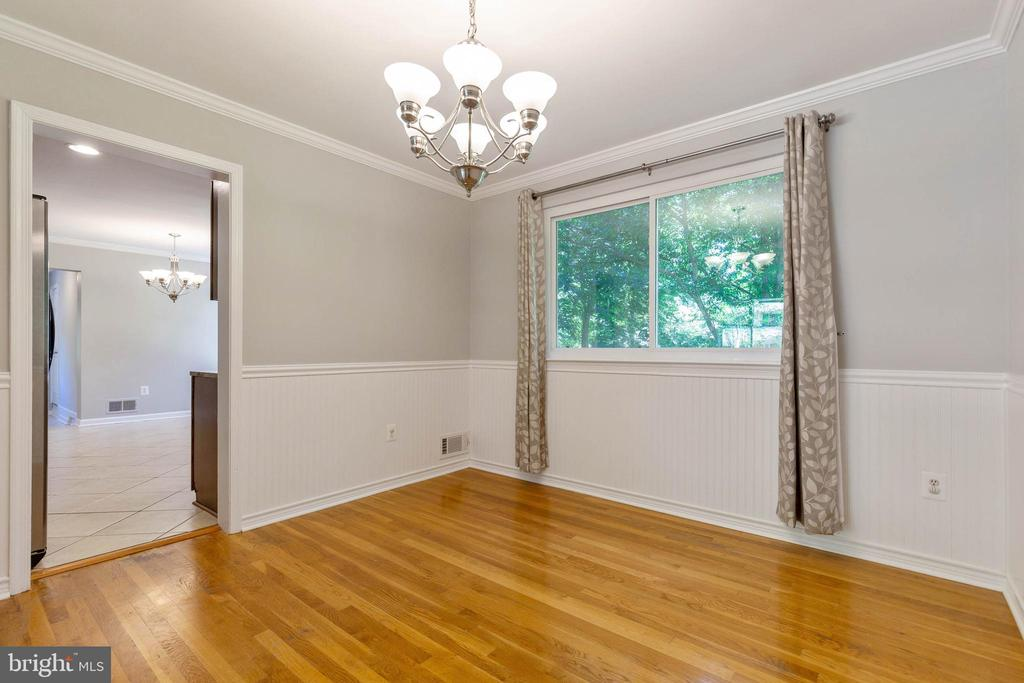Dining room with wainscoting and crown molding - 5119 LAVERY CT, FAIRFAX