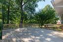 Deck overlooks landscaped yard - 5119 LAVERY CT, FAIRFAX