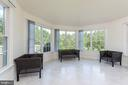 Inviting Sundrenched Sunroom w/ backyard view - 25558 MIMOSA TREE CT, CHANTILLY