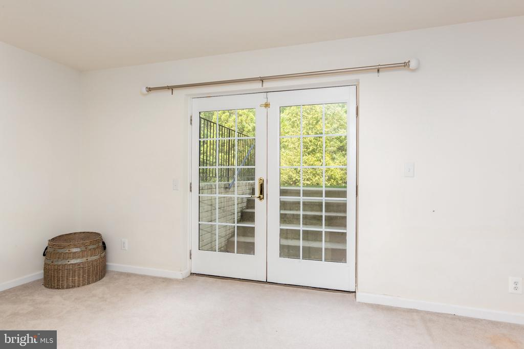 Doors for walk up access to Backyard. - 25558 MIMOSA TREE CT, CHANTILLY