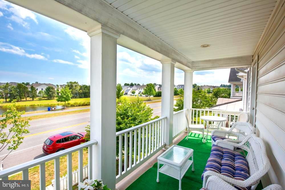 Upper fornt porch - 25091 RIDING CENTER DR, CHANTILLY