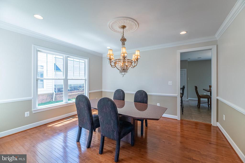 Separate dining room perfect for hosting - 23068 PECOS LN, BRAMBLETON