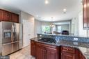 Large pantry and 2 door refrigerator - 23068 PECOS LN, BRAMBLETON