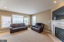 Cozy family room with gas fireplace - 23068 PECOS LN, BRAMBLETON