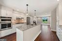 Kitchen is bright and airy. Walks out to deck - 15012 CLOVER HILL RD, WATERFORD