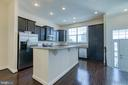 Full kitchen with breakfast bar / island - 225 COBBLE STONE DR, WINCHESTER