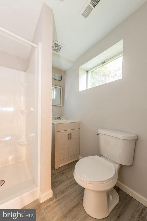 Full basement bath with brand new finishes. - 7100 LAKETREE DR, FAIRFAX STATION