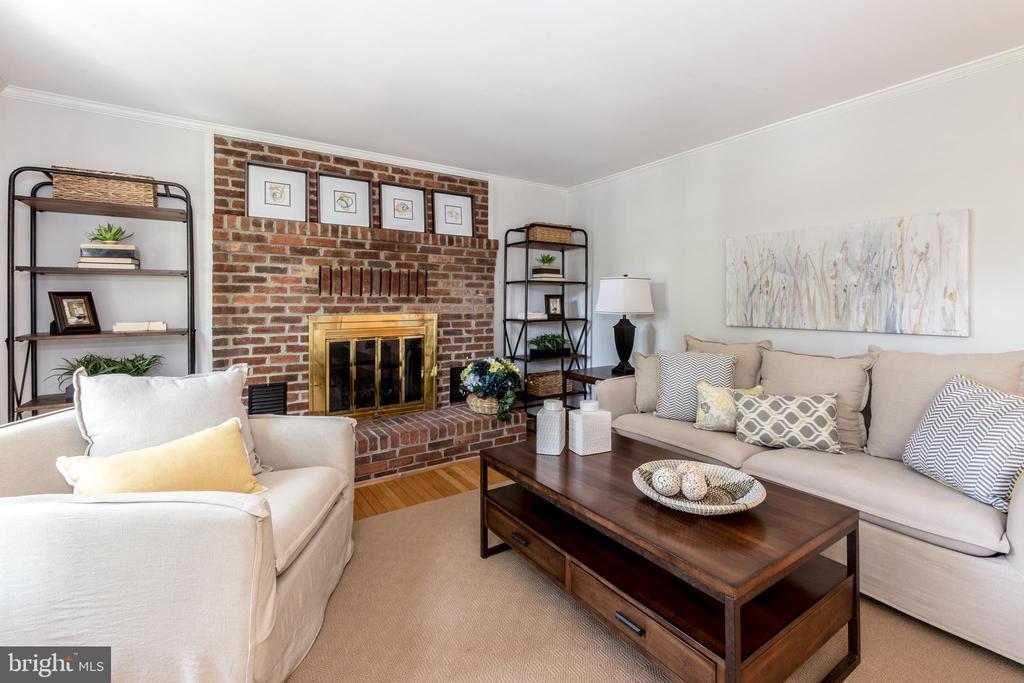 Family Room boasts a wood-burning fireplace! - 7100 LAKETREE DR, FAIRFAX STATION