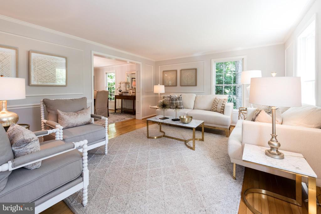 Living room with custom moldings and trim! - 7100 LAKETREE DR, FAIRFAX STATION