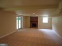 Great room with wood burn fireplace - 13426 CAVALIER WOODS DR, CLIFTON