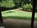 back yard view from basement - 13426 CAVALIER WOODS DR, CLIFTON