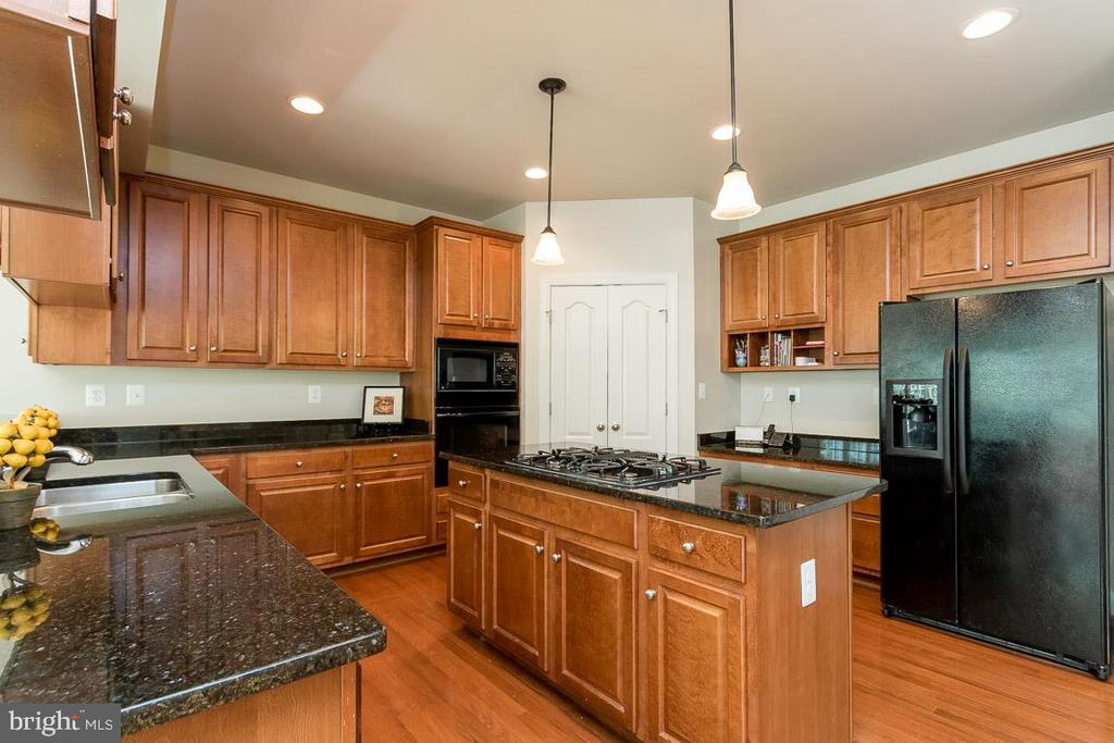 Kitchen with Ample Cabinets and Gleaming Granite - 8637 CHANGING LEAF TER, BRISTOW