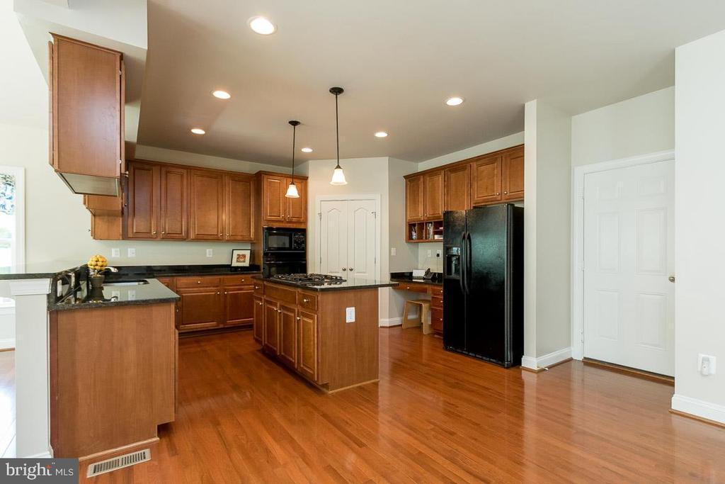 Kitchen with Built-In Desk & Door to Garage - 8637 CHANGING LEAF TER, BRISTOW