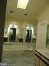 Master bath with skylight - 13426 CAVALIER WOODS DR, CLIFTON