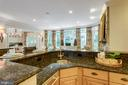Kitchen bar/Prep Area/Counter Seating - 7787 GLENHAVEN CT, MCLEAN