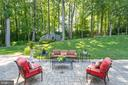 Custom patio looking at fireplace and studio - 7787 GLENHAVEN CT, MCLEAN