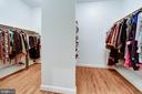 Her walk in closet with shelving / shoe racks - 7787 GLENHAVEN CT, MCLEAN