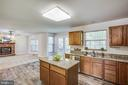 Kitchen opens to family Room - 8 JONQUIL PL, STAFFORD