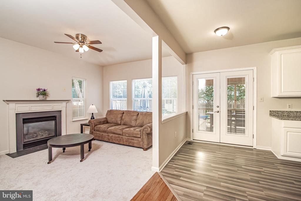 light filled family room with cozy gas fireplace! - 11 CANDLERIDGE CT, STAFFORD