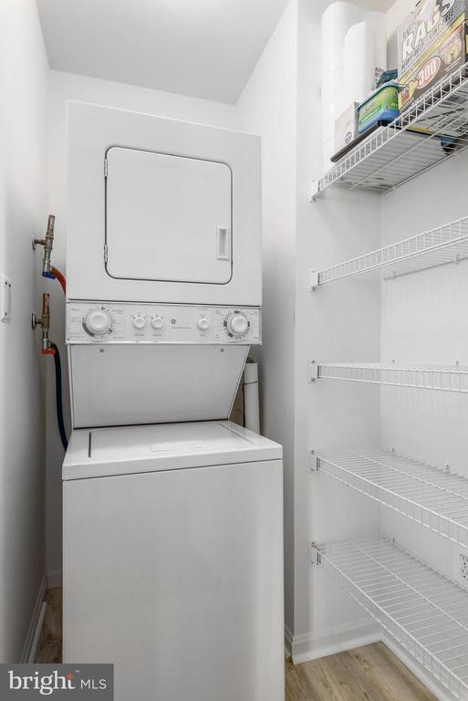 Laundry with plenty of shelf space - 19365 CYPRESS RIDGE TER #715, LEESBURG