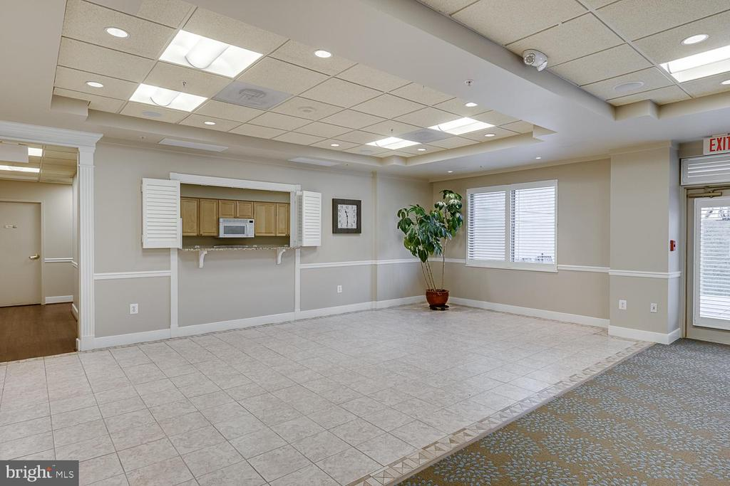Community Room  with walk out patio area - 19365 CYPRESS RIDGE TER #715, LEESBURG
